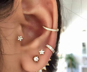 flower, gold, and ear piercing image