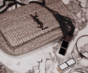handbag, jewelry, and lipstick image
