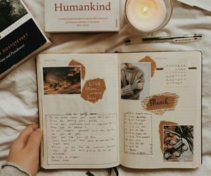 book, candle, and notebook image