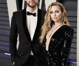 miley cyrus, liam hemsworth, and oscars image