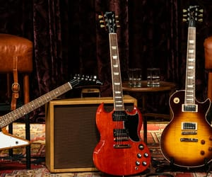 epiphone, gibson les paul, and orange amps image