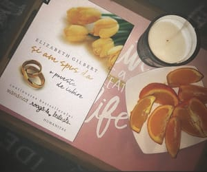 book, oranges, and candle image