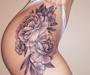 black ink, flower tattoo, and body art image