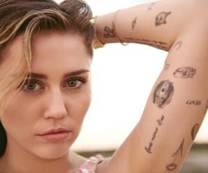 miley cyrus, singer, and tattoo image
