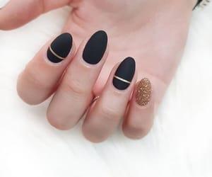 black, gold, and nails image