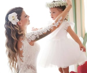 bride, flower girl, and wedding day image