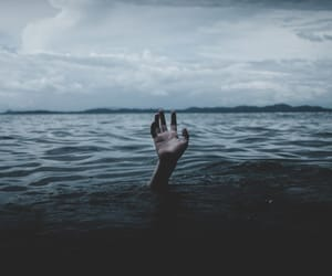 hand, blue, and ocean image