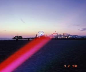 beach, pier, and ferris wheel image
