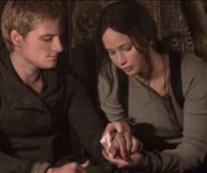 the hunger games, katniss, and peeta image