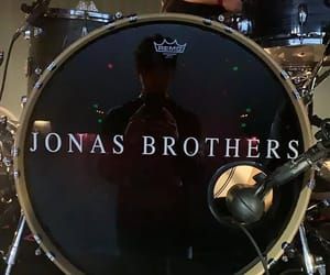 amo, JB, and band image
