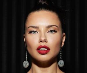 Adriana Lima, eyeliner, and famous image