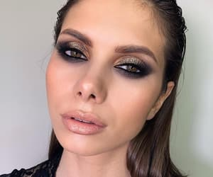 Black Eyeliner, blush, and eyeshadow image