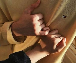 black sweater, couple, and holding hands image