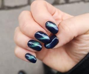 cateye, dark nails, and short nails image
