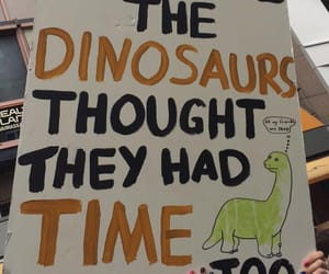 climate change, demonstration, and dinosaurs image