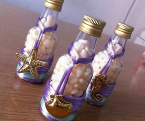bottles, mermaid, and starfish image