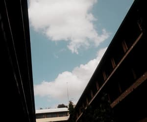 building, clouds, and sky image
