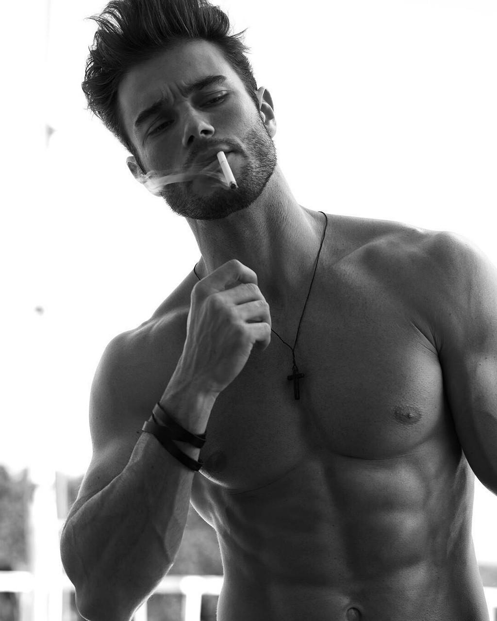 Bad boy confident sexy masculine man stock photo