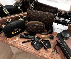 chanel, Louis Vuitton, and Prada image