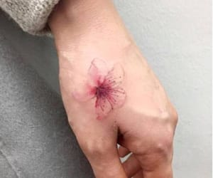 flower, hand tattoo, and pink image
