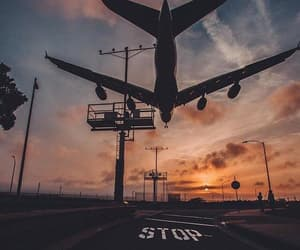 airplane and sunset image
