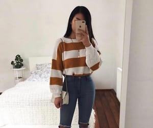 ripped jeans, mini purse, and white low tops image