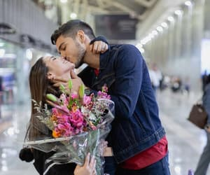 airport, boy and girl, and flowers image