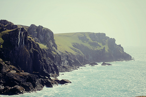 beach, rocks, and sky image