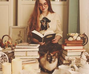 books, cat, and girl image