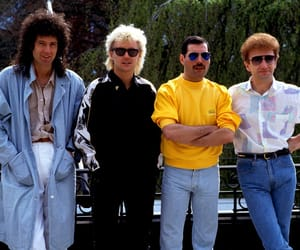 Freddie Mercury, roger taylor, and queen band image