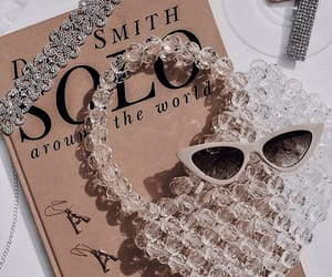 book, details, and jewelry image