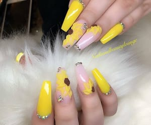 nails, sunflower, and yellow image