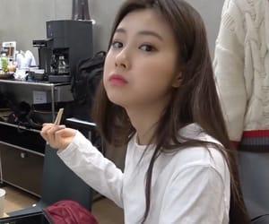 hyewon, izone, and lq image