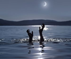 moon, sea, and hands image
