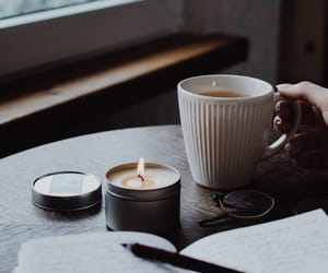 books, candles, and coffee image