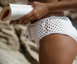 bikini, sand, and books image