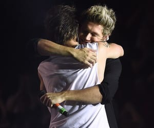 niall horan, louis tomlinson, and otra tour image