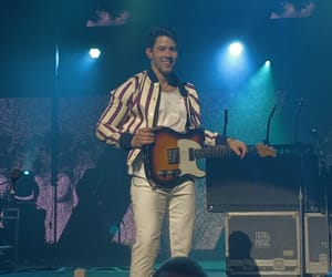 nick jonas and guitarists image