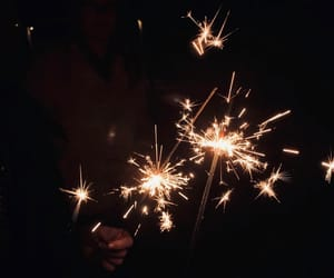 black, fire, and firework image