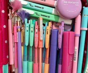 pencil case, pens, and school image