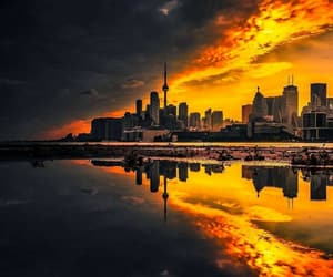cityscape, ocean, and reflections image