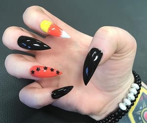 candy corn, claws, and Halloween image