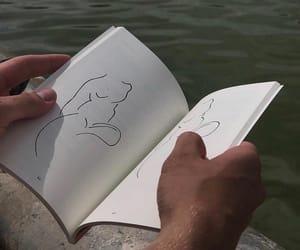artwork, books, and female image