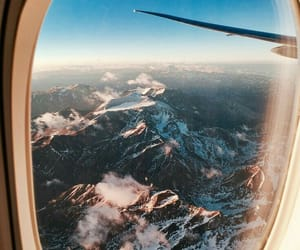 travel, mountains, and airplane image