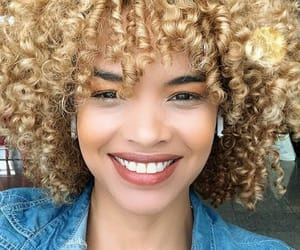 black woman, blonde, and golden image