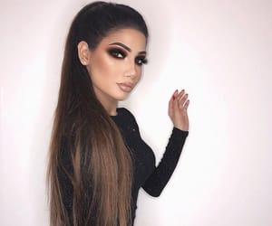 black dress, makeup, and hair image