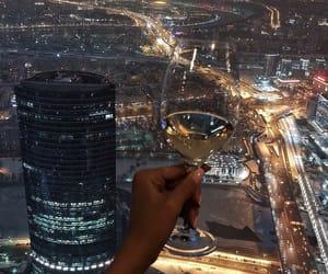 city, wine, and light image