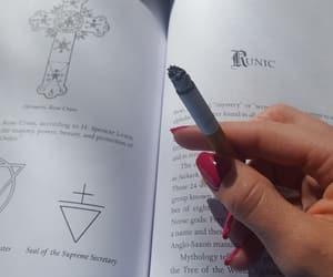 book, cross, and smoke image