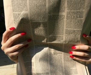 nails, newspaper, and red image