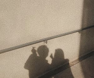 couple, shadow, and sun image